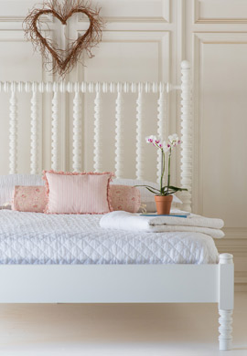 wooden beds with low footboards