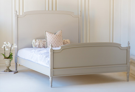 Wooden beds with medium and high footboards